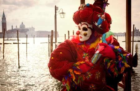 Venetian Carnival clown with gondolas