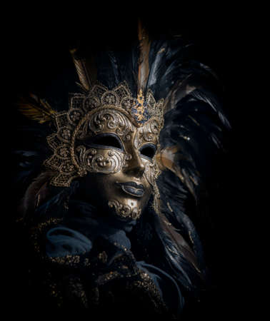 black mask: luxorious venetian mask isolated on black background Stock Photo