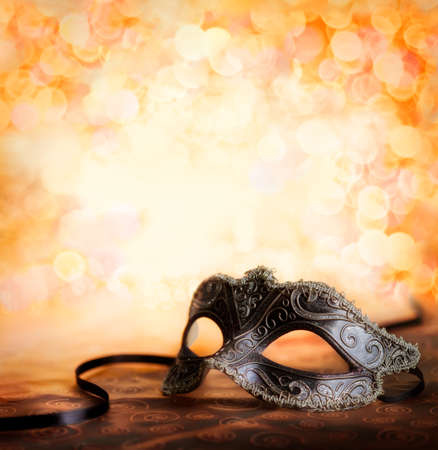 new year s eve: mask with glittering background Stock Photo