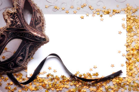 masquerade masks: party still life with blank paper for your text Stock Photo