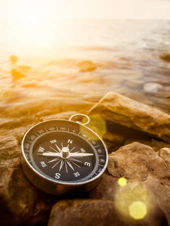 travel concept: compass on the bank