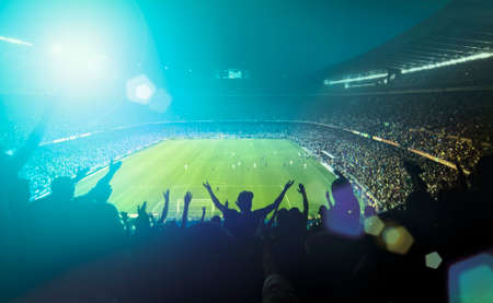 soccer sport: crowded football stadium