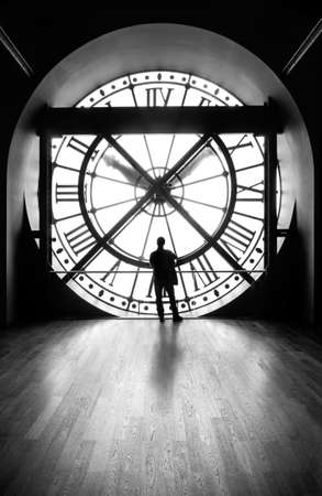 clock with a silhouette of a man, b&w image