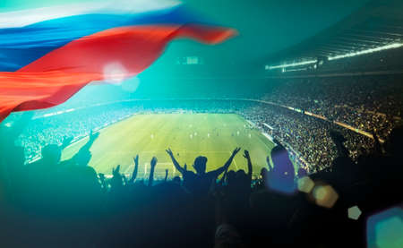 Crowded stadium with russian flag Stock Photo