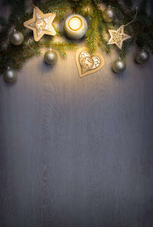 Christmas fir tree with decoration and candle on wooden board Archivio Fotografico