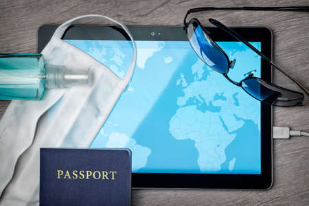 safe traveling during a pandemic crisis, mask, map and other accessories