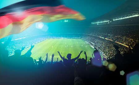 crowded football stadium with german flag