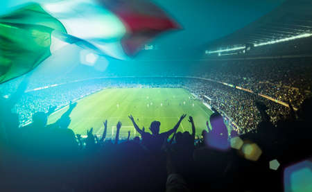 crowded football stadium with italian flag
