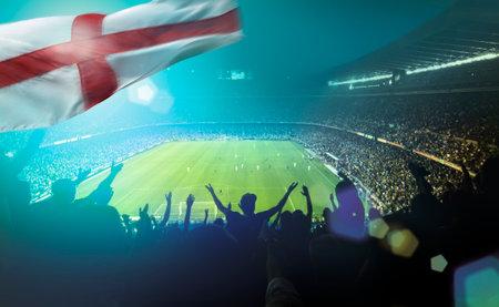 crowded football stadium with the english St George flag Standard-Bild