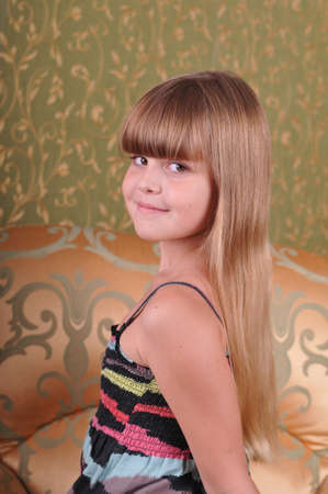 turn over: Turn over portrait of young girl with blond long hair