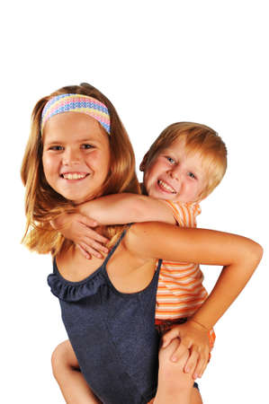 Brother and sister portrait together happy and smiling, looking at camera isolated on white photo