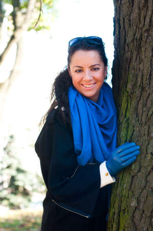 leather gloves: Pretty smiling middle age woman portrait closeup