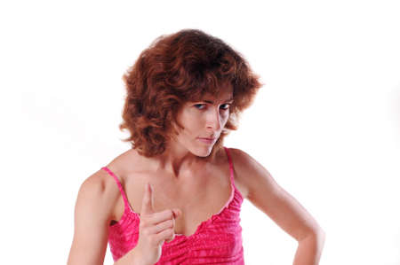 curly headed: Angry woman portrait looking at camera and making threatening gestures Stock Photo