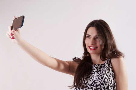 selfy: Pretty woman selfy with mobile phone Stock Photo