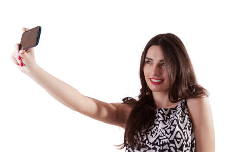 selfy: Pretty woman selfy with mobile phone isolated on white Stock Photo