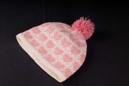 pink hat: Pink hat on black background at studio