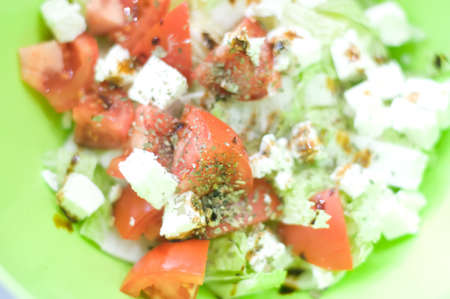 Greek salad in big green bowl closeup