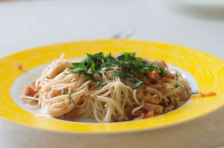 Italian spaghetti with chiken and paprika in white plate on the table Stock Photo
