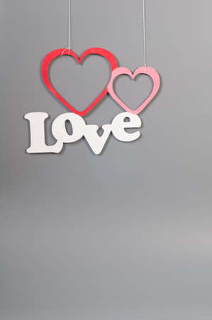 Background for love and romance on grey two hearts and text