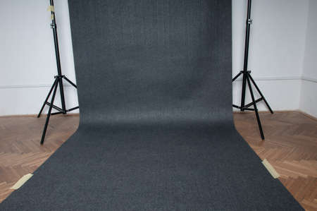 Studio background grey color on the floor hanging on photo racks