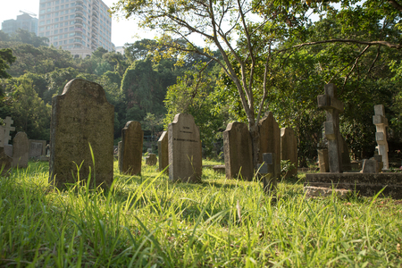 Cemetery in Hong Kong downtown on sunny day