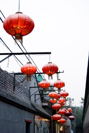 Chinese new year red lanterns hanging along the old beijing hutong