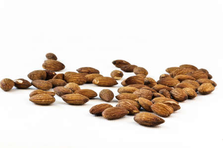 Almonds on isolated white background