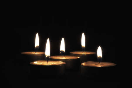 Candles on black background 3 Stock Photo
