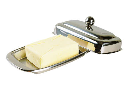 Butter in a chromed metal box. Isolated on white.