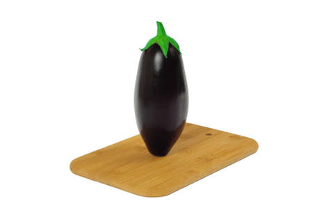 Eggplant on wooden board isolated on white Stock Photo - 10720494
