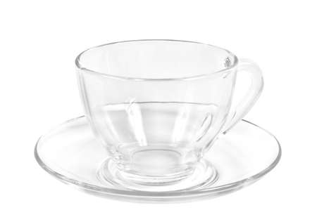 Transparent tea or coffee cup and saucer on a white background.