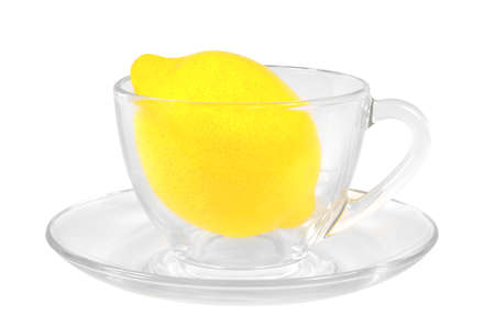 Fresh lemon in a transparent glass cup on white backgroung.