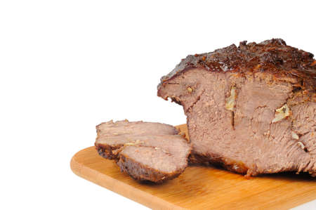 Roast beef on a wooden board. Isolated on white.