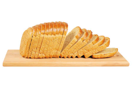 Sliced bread on wooden board. Isolated on white.