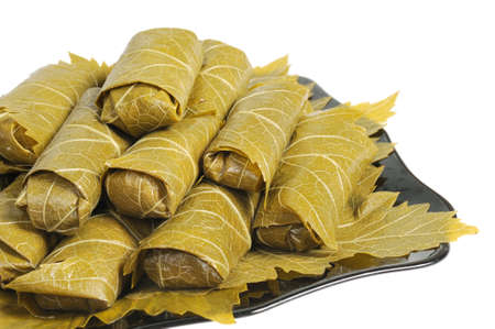 Dolma on a black plate. Isolated on white background. Stock Photo