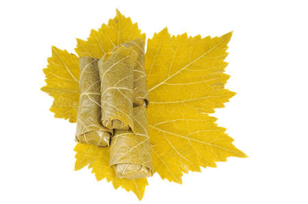 Dolma on grape leaf. Isolated on white background. Stock Photo