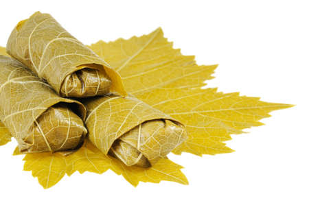Dolma on grape leaf. Isolated on white background. Stock Photo