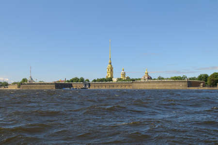Russia, Saint-Petersburg, Peter and Paul Fortress. against blue sky photo
