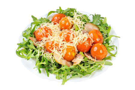 Salad with arugula and tomatoes. Isolated on white. photo