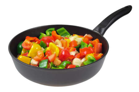 roasting pan: Roasting pan with the vegetables. Red and green peppers, onions, tomatoes. Isolated on white