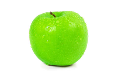 Wet green apple with water spray isolated on white photo