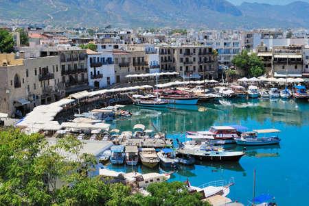 Seashore with a pier. Tourist center of Kyrenia, Cyprus. Archivio Fotografico
