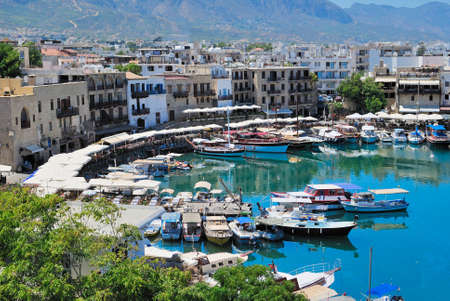 Seashore with a pier. Tourist center of Kyrenia, Cyprus. Imagens