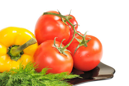Vegetables - Tomatoes, peppers on a plate with dill. Isolated on white. Stock Photo - 11252035
