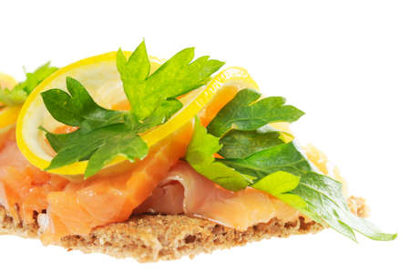 Sandwich snack - salmon with lemon on rye bread. Isolated on white. Stock Photo