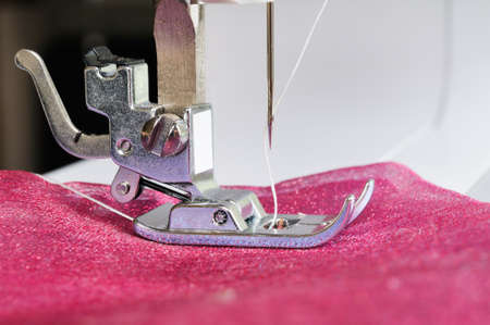 Sewing machine close up with a cloth. photo