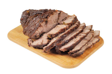 Roast beef on a wooden board  Isolated on white