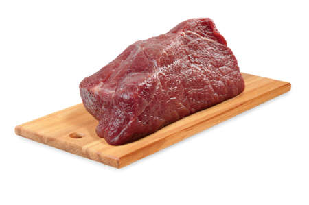 Beef on a wooden board  Isolated on white Stock Photo