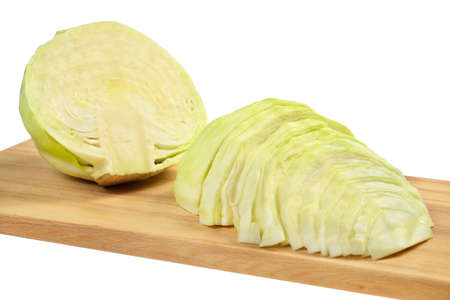Cabbage on a cutting board  Isolated on white