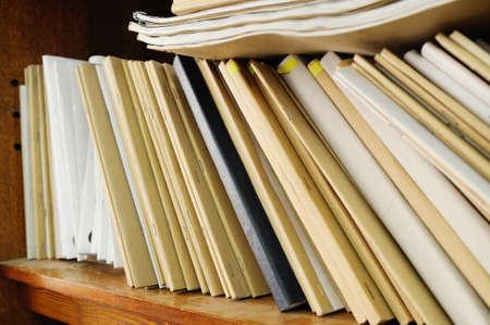 archival: Wooden shelf with file folders, archival documents